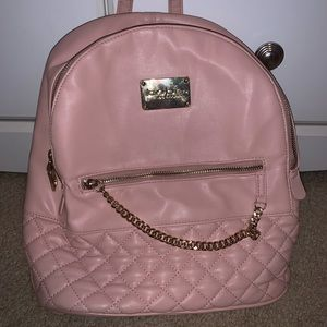 Baby pink and gold bebe backpack